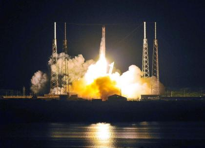 SpaceX's Falcon 9 rocket as it heads for space carrying the company's Dragon spacecraft from pad 40 at Cape Canaveral, Florida.