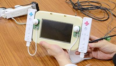 first_wii_u_gamepad_prototype_was_two_wii_remotes_and_a_monitor_taped_together