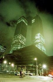 (AP Photo/Ron Frehm, File). FILE - In this file photo of Feb. 26, 1993, the twin towers of the World Trade Center in New York City are shown in the aftermath of an explosion earlier that day.