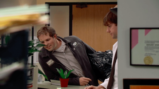 The way the shot is framed, we see Jim and Pam being flirty at the reception desk, and then Roy walks into the office and comes between them. It's our very first glimpse at this love triangle in action. Symbolic AF!!!
