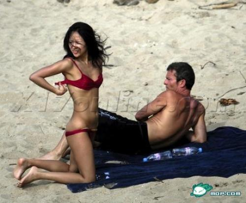 "Zhang Ziyi vacationing on the beach with her boyfriend Aviv ""Vivi"" Nevo."