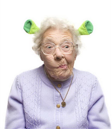 Crazy old lady wearing Shrek ears.