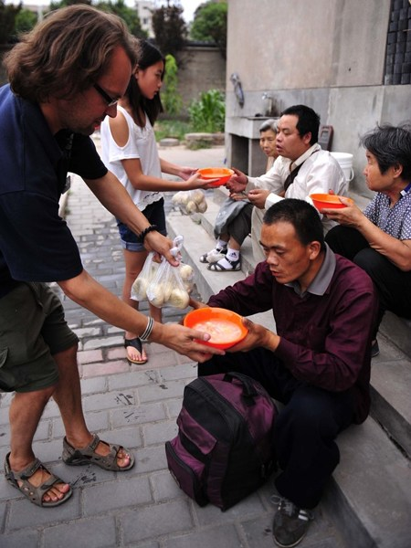Tony and his crew are offering food to people.