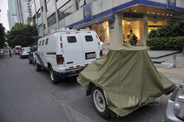 Police bomb squad vehicles at an apartment building in Guangzhou, China.