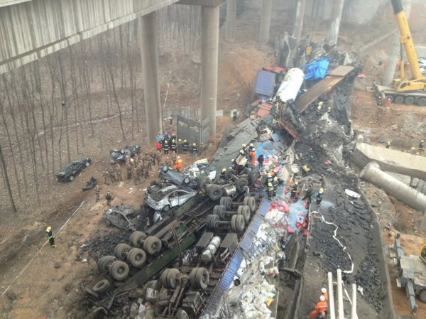 Emergency rescue personnel at the scene of the collapsed Yichang Bridge in Henan province on 2013 February 1 coupled with the explosion of a truck carrying explosives, possibly fireworks.