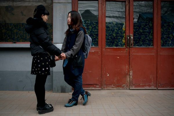 Elsie and Mayu are walking out of Dongcheng District Social Service Center.