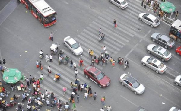 """Chinese Style Street Crossing"", describing phenomenon where Chinese pedestrians will cross a street as long as they are in a group regardless of whether or not the light is red."