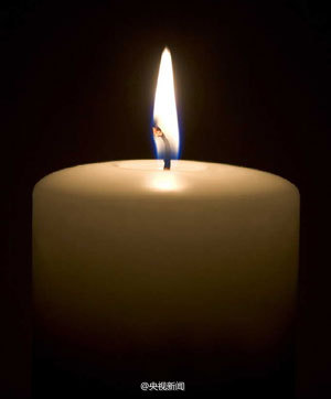 A lit candle with flame.