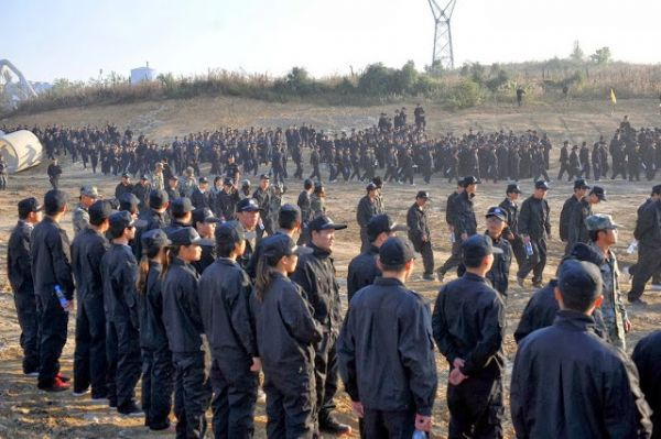 chinese-student-forced-demolition-in-fake-police-uniform-08