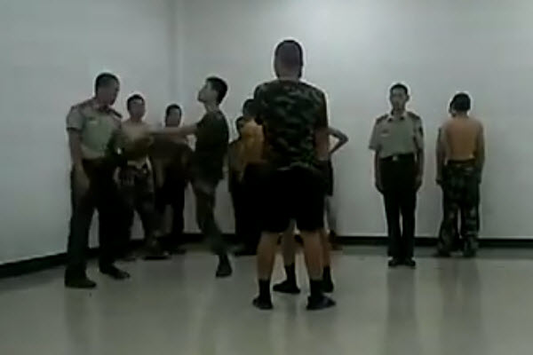New Chinese soldier recruits in Inner Mongolia Wuhai city being beaten, bullied, and hazed by veterans.