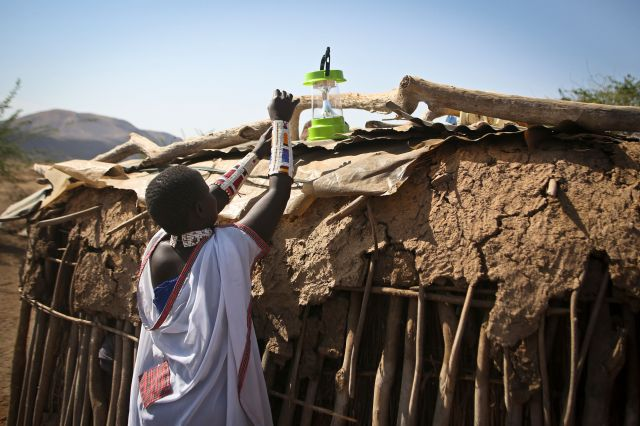 "<span class='image-component__caption' itemprop=""caption"">A Maasai woman sets up a solar light to recharge in the village of Koora, Kenya.</span>"