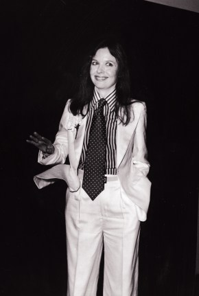 American actor and director Diane Keaton poses with a big smile and tilted head at the 48th Academy Awards and wears a white suit with a carnation in the lapel, striped shirt, and polka dot tie, Los Angeles, California, March 29, 1976. (Photo by Frank Edwards/Fotos International/Getty Images)