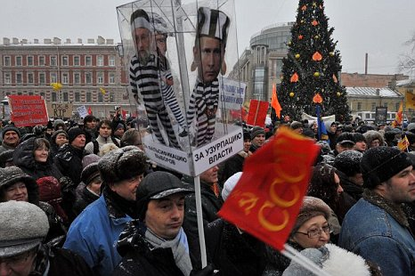 Protesters in Moscow carry a model of a prison cell containing the figure of Prime Minister Putin during a rally against the alleged rigging of the December 4 general election