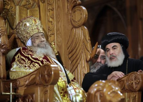 The body of Pope Shenouda III, seated on the throne of St. Mark