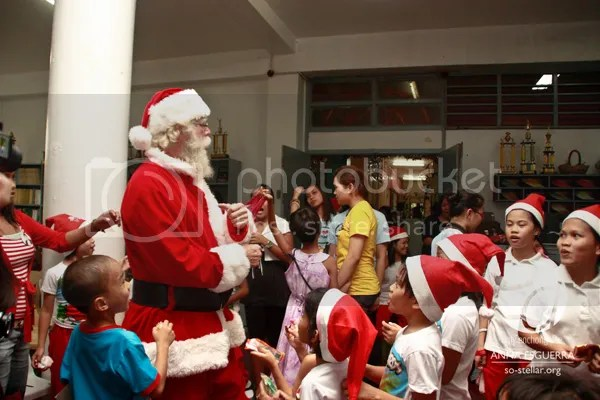Santa playing with the kids