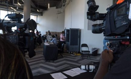 Media crews film while election workers process absentee ballots at State Farm Arena in Atlanta on Nov. 2, 2020. (Megan Varner/Getty Images)