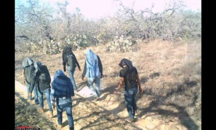 A game camera captures illegal immigrants walking through private ranch land in Jim Hogg County, Texas, on March 25, 2021. (Courtesy of Susan Kibbe)
