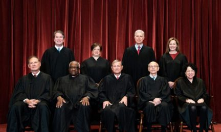 Seated from left: Associate Justice Samuel Alito, Associate Justice Clarence Thomas, Chief Justice John Roberts, Associate Justice Stephen Breyer, and Associate Justice Sonia Sotomayor, standing from left: Associate Justice Brett Kavanaugh, Associate Justice Elena Kagan, Associate Justice Neil Gorsuch, and Associate Justice Amy Coney Barrett pose during a group photo of the Justices at the Supreme Court in Washington on April 23, 2021. (Erin Schaff/Pool/AFP via Getty Images)