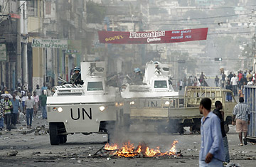 U.N. peacekeepers patrol in an armored vehicle during protests on a street in Port-au-Prince, Haiti.