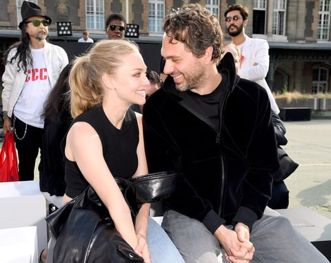 Amanda Seyfried and Thomas Sadoski attend the Givenchy Menswear Spring/Summer 2017 show as part of Paris Fashion Week on June 24, 2016 in Paris, France.
