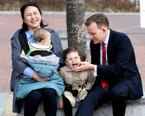 Robert Kelly, right, a political science professor at Pusan National University, waits for a press conference with his wife Jung-a Kim, left, and children James and Marion, at the university in Busan, South Korea, Wednesday, March 15, 2017.