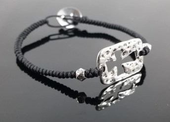 Black macramé bracelet with pewter cross and accent beads.