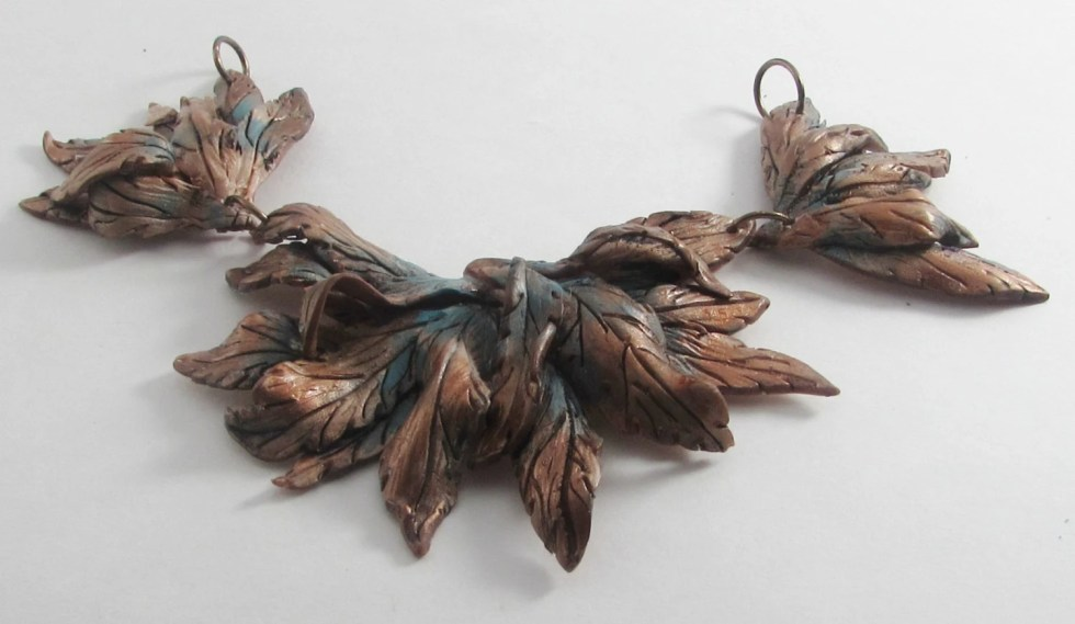 Copper color bib necklace...