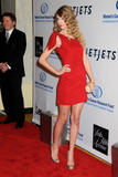 Taylor Swift leggy in red dress at 15th Annual Saks Fifth Avenue's Unforgettable Evening - Hot Celebs Home
