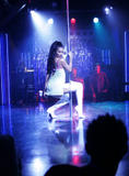 Roselyn Sanchez as an exotic dancer dances in lingerie around stripper pole