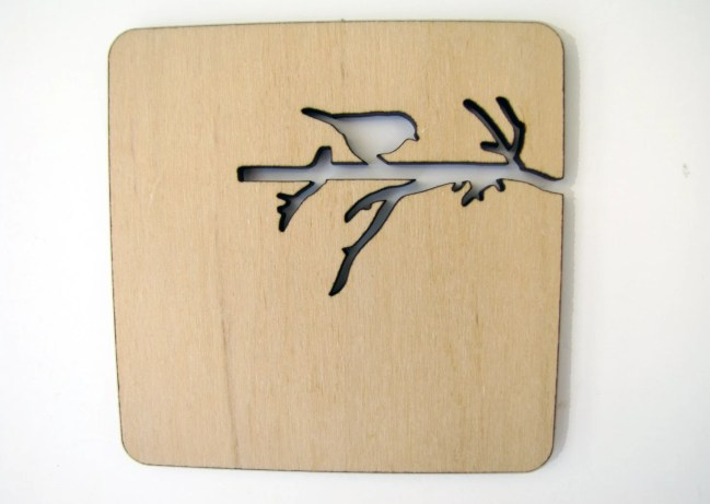 Laser cut wood coasters. Branch with bird and squirrel.