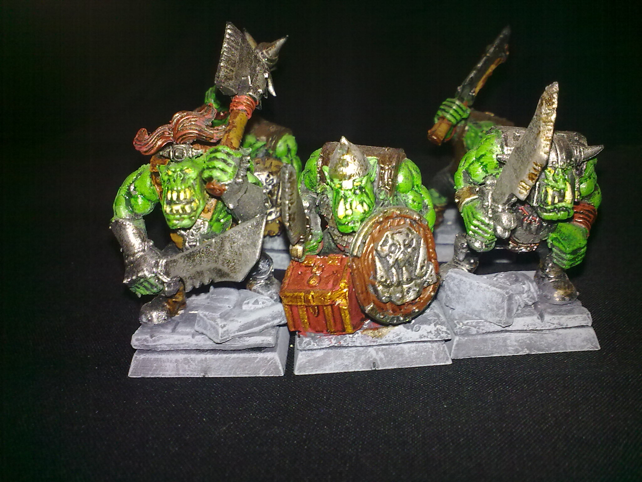 Close-up of the Orcs, the customised bases are made from spare parts from Warhammer models and custom molds