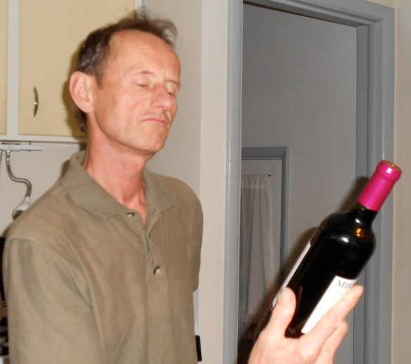 Jim examining wine bottle