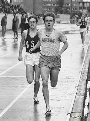 Rick dueling it out with Steve Prefontaine at a WSU-Oregon track meet.