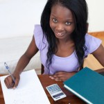 http://www.dreamstime.com/royalty-free-stock-images-smiling-afro-american-teen-girl-doing-her-homework-image13861139