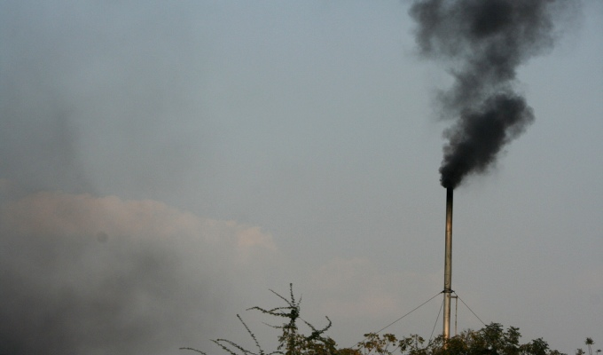 In a departure from its traditional stand, Indian negotiators are now pondering over an announcement of a peaking year for the country's greenhouse gas emissions. (Image by Vijay Chennupati)
