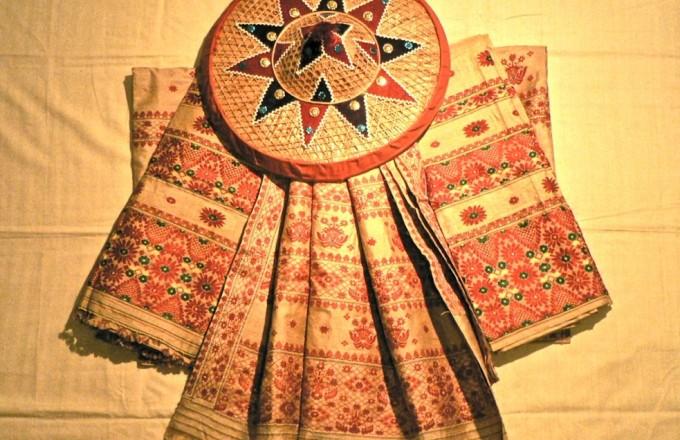 A set of mekhela chadors made with Assamese muga silk arranged around a japi (Image by Satnath)