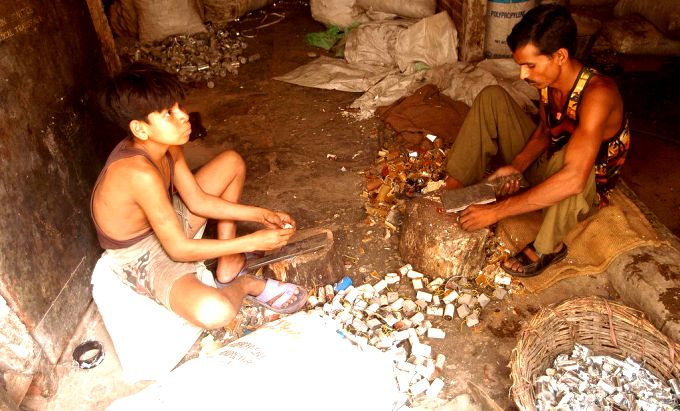 A child handling hazardous e-waste (Image by Greenpeace/Hatvalne)