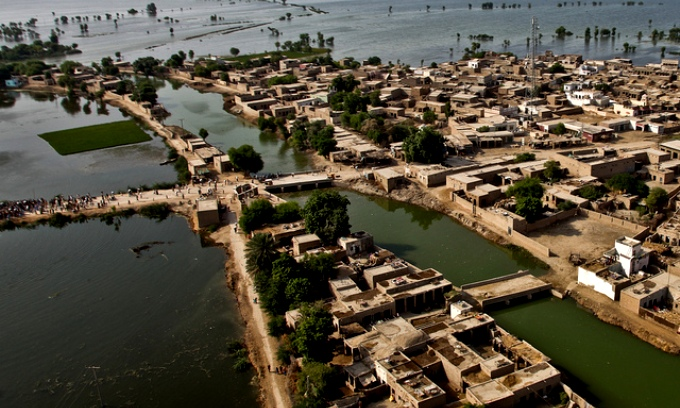 An aerial view of a town surrounded by flood water as U.S. Marine Pilots from the 26th Marine Expeditionary Unit begin their landing approach to deliver food supplies in support of the Pakistan flood relief effort in Pano Aqil, Pakistan on September 14, 2010. (U.S. Army photo by Staff Sgt. Wayne Gray/Released)