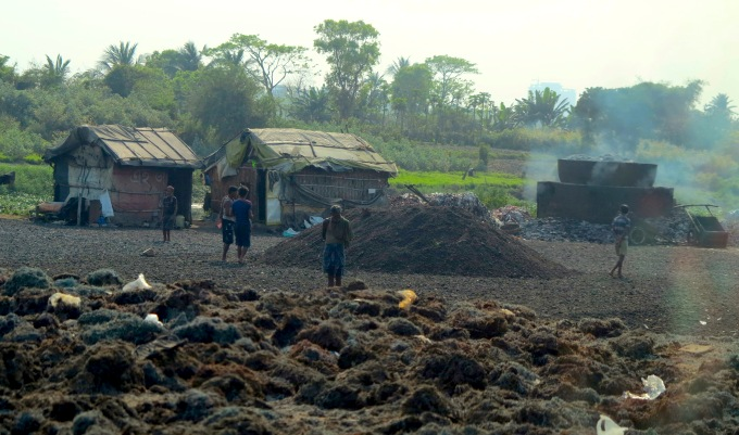 Leather waste is being boiled in a cauldron in an illegal processing unit (Dhrubajyoti Ghosh)