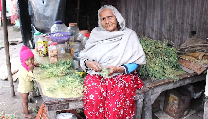 75-year-old Afsa Begum sells biscuits and fryums for kids who come to study in the madrasa housed in a crumbling 15th century mosque complex on the outskirts of Patna, Bihar, where she, her daughter-in-law and two-year-old granddaughter have squatted since years. Her husband is dead and her son left for Mangalore to work for a construction contractor after the severe monsoon floods in 2016. He has sent money only once. (Photo by Manipadma Jena)
