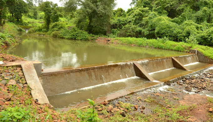 A small check dam helps in water harvesting in a semi-arid region (Photo by WOTR)