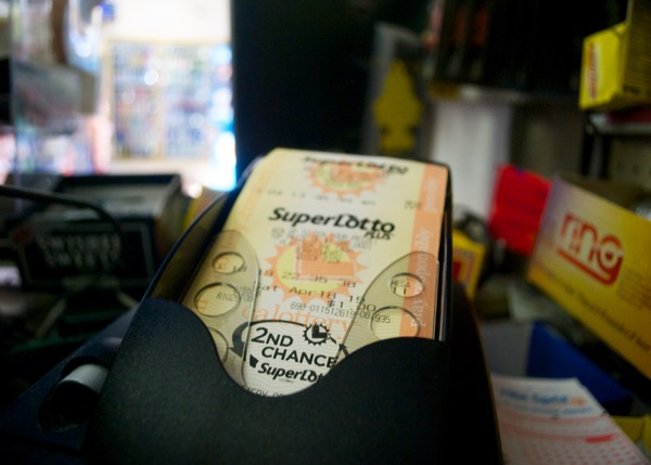 A machine at King's Liquor prints out SuperLotto Plus tickets. Credit: Leo Castaneda/inewsource