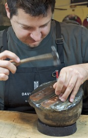 Artist David Bigazzi works on an alloy bracelet in his Menlo Park workshop - InMenlo.com