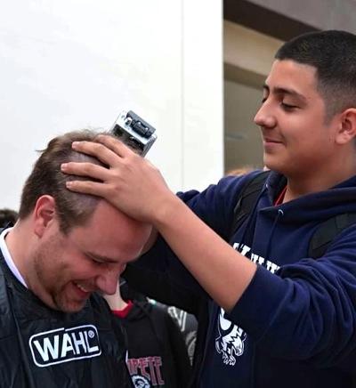 Erik Burmeiser head shaving