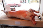A whole lamb carcass on butcher's block