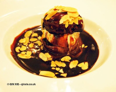 Profiteroles with chocolate sauce and almond flakes at The Lawn Bistro