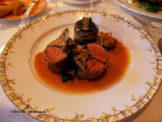 """Roasted loin of lamb stuffed with aubergine confit and grilled pine kernels, """"gâteau"""" of moussaka and a light saffron flavoured jus, The Waterside Inn, Bray"""