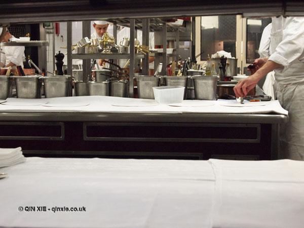 Kitchen through hot pass, 25th Anniversary Celebration Menu at Alain Ducasse's Le Louis XV in Monte Carlo, Monaco