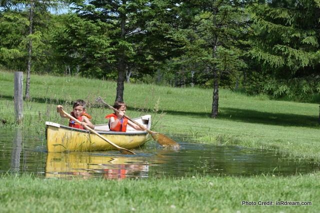 Kids Canoeing, Splashing in the pond. Kawartha Lakes Pond, Country living in Kawartha Lakes
