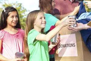 children-donating-to-charity